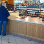 in-store sales transaction counter and tobacco cabinets
